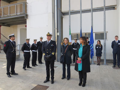 A solemn moment: the flags are raised by sailors of the Italian Navy