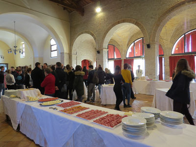In one of the venerable halls of the former monastery, a large cold buffet awaited the guests.