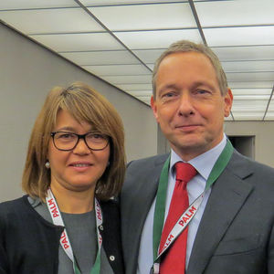 the newly-elected President Remco Koerts with Ana Paula Païs as they leave the meeting room