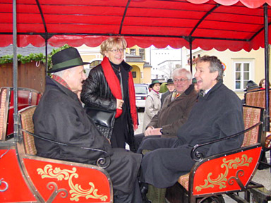 the dignitaries travel in the open carriage