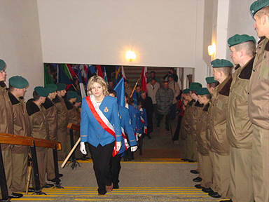 At the church entrance, the line of soldiers forming the passage for the standards and the participants.