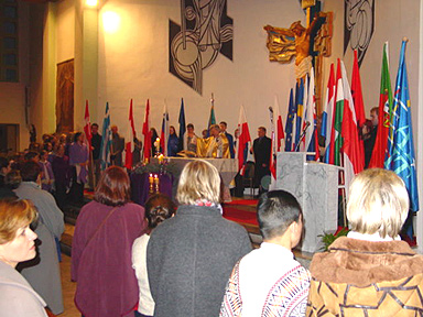 The standards of all the delegations surrounding the altar.