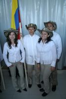The four Colombian students wearing their traditional costumes. (Photo Sébastien Longhurst)