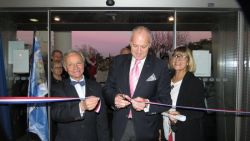A solemn moment – the ribbon is cut to open the exhibition to all visitors