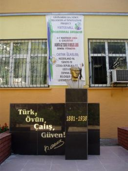Ataturk statue outside Bornova High School, with the Welcome to Virtex4all banner behind