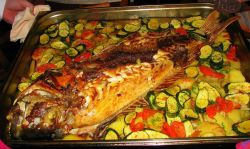 Roasted fresh fish served with roasted vegetables and potatoes