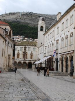in the background : The Sponza Palace housed once the custom office and its warehouse. Nowadays it is the home of ' the Archive'. at the l. : The Town Hall (building bearing flags)